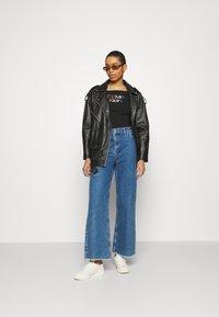 Calvin Klein - PIPING LOGO BARDOT - Print T-shirt - black - 1
