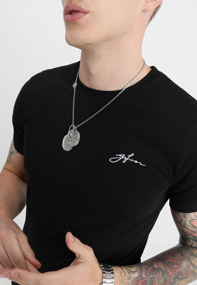 Good For Nothing BASIC LOGO CARRIER - Basic T-shirt - black RhYT9