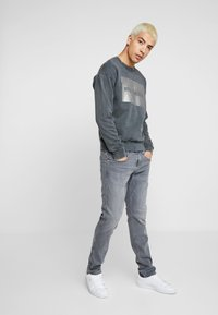 Replay - ANBASS - Slim fit jeans - medium grey - 1