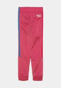 adidas Originals - TRACKPANT UNISEX - Tracksuit bottoms - wild pink - 1