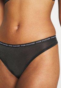 Calvin Klein Underwear - ONE GLISTEN THONG - Thong - black - 4