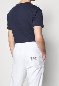 EA7 Emporio Armani - Tracksuit bottoms - white/black - 4