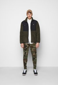 Polo Ralph Lauren - Tracksuit bottoms - olive - 1