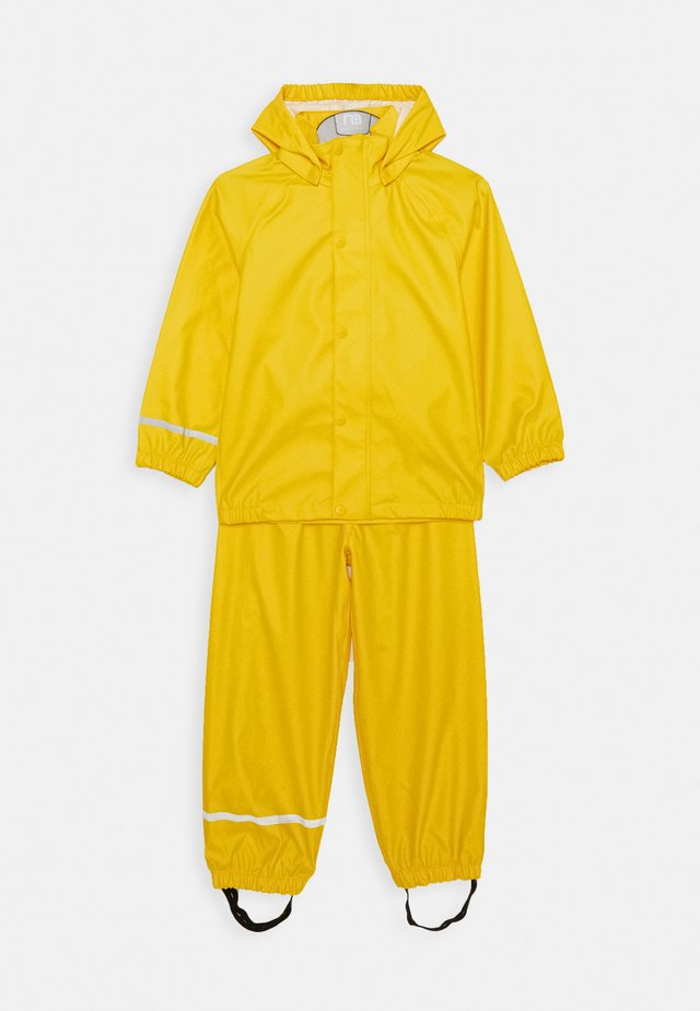 NKNDRY RAIN SET - Rain trousers - empire yellow
