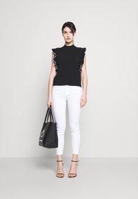 KARL LAGERFELD - COLORBLOCK RUFFLE CROP - Print T-shirt - black - 1