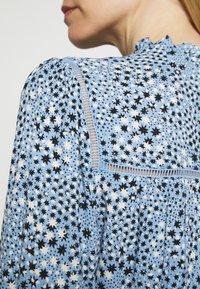 Marks & Spencer London - STAR FRILL PEPLUM - Blouse - blue - 7