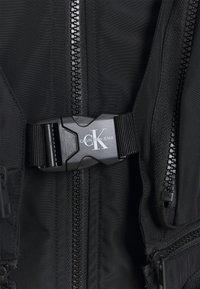 Calvin Klein Jeans - TECHNICAL 2 IN 1 UTILITY JACKET - Waistcoat - black - 3