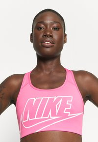 Nike Performance - FUTURA BRA - Sujetadores deportivos con sujeción media - pinksicle/white - 3
