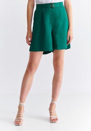 DOMIKI - Shorts - green