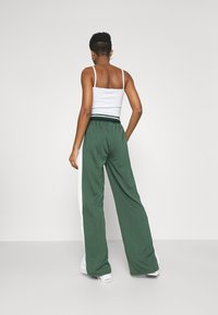 Missguided - PLAYBOY VARSITY WIDE LEG TRICOT PANTS - Tracksuit bottoms - green - 2