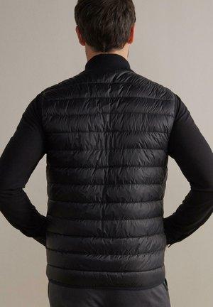 WENDEDAUNEN AUS CASHMERE - Waistcoat - schwarz