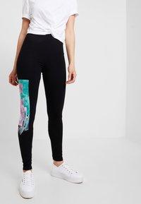 Desigual - PORTRAIT - Leggings - Trousers - black - 0