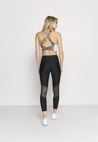 Under Armour - ROCK ANKLE - Leggings - black - 2