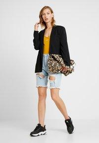 Nike Sportswear - W NSW ESSNTL TANK BDYSUIT LBR - Top - gold/white - 1