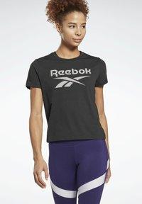 Reebok - WORKOUT READY SPEEDWICK - T-shirts med print - black - 0