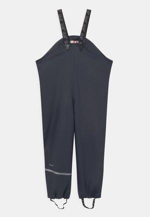 RAINWEAR PANTS  RAINWEAR UNISEX - Rain trousers - dark navy