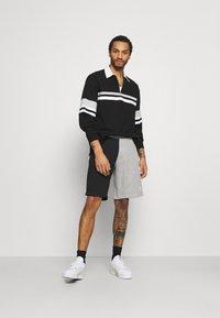 adidas Originals - BLOCKED UNISEX - Shorts - black - 1