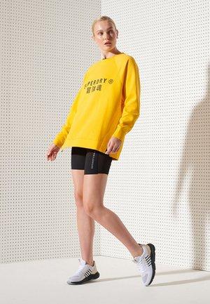 Pantalón corto de deporte - black