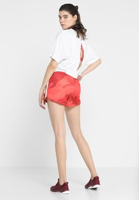 Craft - DISTRICT HIGH WAIST SHORTS - kurze Sporthose - red/orange - 2