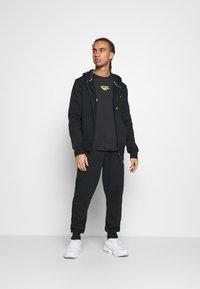 Hi-Tec - ARCHIE BASIC JOGGER - Pantaloni sportivi - black - 1