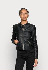 Vero Moda - VMKHLOE JACKET - Bunda zumělé kůže - black - 0