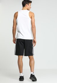 adidas Performance - Sports shorts - black - 2