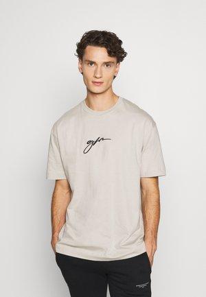 OVERSIZED SCRIPT - T-shirt print - stone