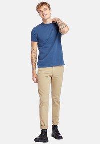 Timberland - Basic T-shirt - dark denim - 1