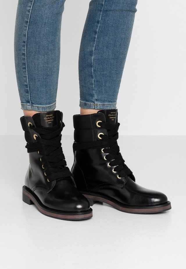 MALIN  - Lace-up ankle boots - black