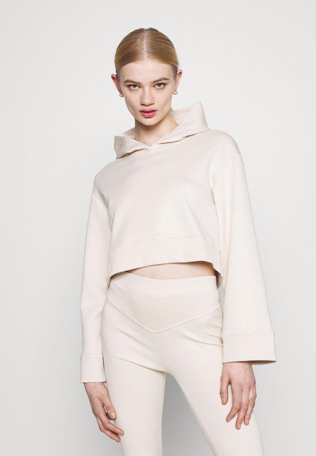 NINETTE HOODY - Sweatshirt - beige