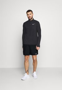 Nike Performance - CHALLENGER - Sports shorts - black/silver - 1