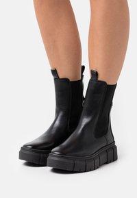 Tamaris - Platform ankle boots - black - 0