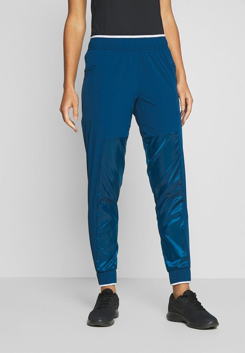 Nike Performance - AIR PANT - Teplákové kalhoty - valerian blue