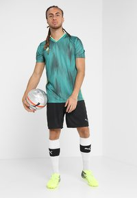 adidas Performance - T-shirt z nadrukiem - actgreen/hireye - 1