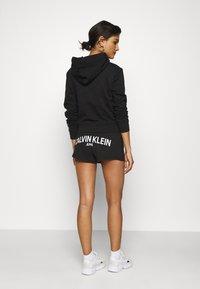 Calvin Klein Jeans - BACK LOGO - Tracksuit bottoms - black - 2
