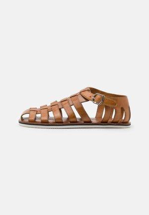 Sandaalit nilkkaremmillä - tan