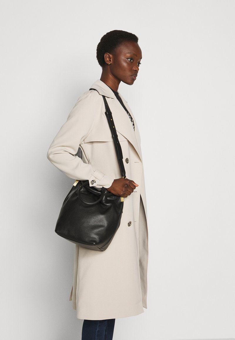 Coccinelle - GABRIELLE SOFT BUCKET - Handbag - noir