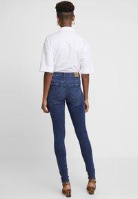 ONLY - ONLPAOLA HIGHWAIST - Jeans Skinny Fit - medium blue denim - 2