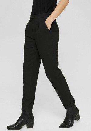 PER HR - Trousers - black