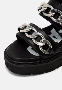 Buffalo - VEGAN ROCKET - Platform sandals - black - 7