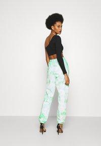 Missguided - PLAYBOY TIE DYE - Pantalones deportivos - mint - 2