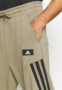 adidas Performance - 3-STRIPES O-PANT FUTURE ICONS - Tracksuit bottoms - orbit green - 5