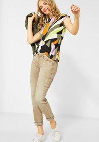 Street One - COLOUR-DENIM IM STYLE - Slim fit jeans - braun - 1