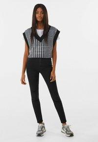 Bershka - SUPER HIGH WAIST - Slim fit jeans - black - 1