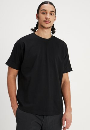 OVERSIZED CUT ON SLEEVE TEE - Basic T-shirt - black