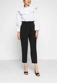 ONLY Petite - ONLSURI AINA PANTS - Kalhoty - black - 0