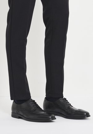 MELBOURNE - Veterschoenen - black