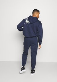 Puma - FRANCHISE - Tracksuit bottoms - peacoat - 2