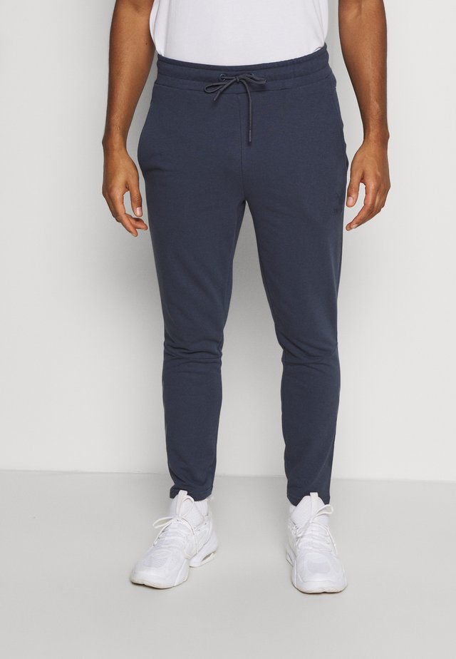ISAM TAPERED PANTS - Trainingsbroek - blue nights