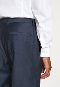 Calvin Klein Tailored - STRETCH SMALL GRID SUIT - Trousers - blue - 6